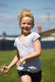 Girl in sports race stock image