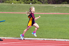 Girl in sports race stock photography