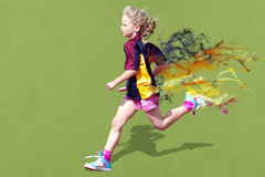 Girl in sports race. A little girl running in a relay sports race Royalty Free Stock Photos