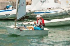 Girl - sports steering yacht in Pomorie. Bulgaria Stock Image