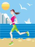 Girl in a sports uniform jogging on beach Royalty Free Stock Photos