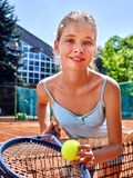 Girl sportsman with racket and ball on  tennis Royalty Free Stock Photo
