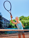 Girl sportsman with racket and ball on  tennis. Girl teen sportsman with racket and ball near net on  tennis court Stock Photo