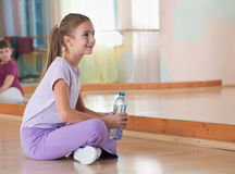 Girl in sportswear with bottle of water Royalty Free Stock Photo