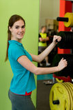 The girl in sportswear choosing the weighs for barbell closeup Stock Photos