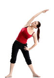 Girl in sportswear doing sport exercises Stock Images