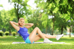 Girl in sportswear exercising in a park Stock Image