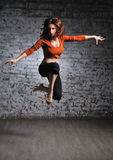 Girl in sportswear jumping Stock Photos