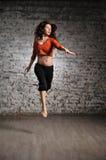 Girl in sportswear jumping Royalty Free Stock Photos