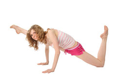 Girl in sportswear makes gymnastic. On white background Stock Images
