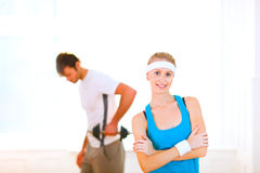 Girl in sportswear and man making sport exercises Stock Photography