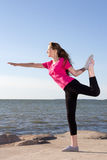 Girl in sportswear trainig near the sea Royalty Free Stock Photos