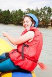 Girl - sportswoman on a raft floats Stock Photos