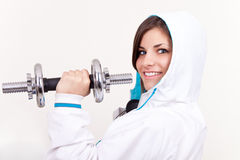 Girl in sportwear holding weights Royalty Free Stock Photos