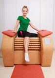 Girl in sportwear on relax massage equipment healthy spa salon Stock Photos