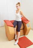 Girl in sportwear on relax massage equipment healthy spa salon Royalty Free Stock Photos