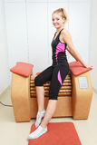 Girl in sportwear on relax massage equipment healthy spa salon Stock Image