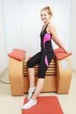 Girl in sportwear on relax massage equipment healthy spa salon Stock Image