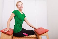 Girl in sportwear on relax massage equipment healthy spa salon Royalty Free Stock Photography