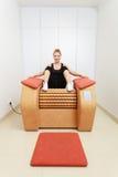 Girl in sportwear on relax massage equipment healthy spa salon Stock Photo