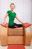 Girl in sportwear on relax massage equipment healthy spa salon Stock Photography