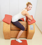 Girl in sportwear on relax massage equipment healthy spa salon Royalty Free Stock Photo
