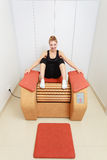 Girl in sportwear on relax massage equipment healthy spa salon Stock Photo