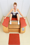 Girl in sportwear on relax massage equipment healthy spa salon Stock Images