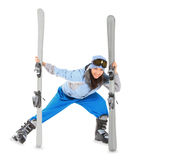 Girl in sportwear with ski isolated over white Stock Photography