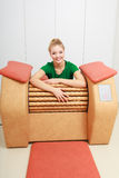 Girl in sportwear using relax massage equipment healthy spa salon Royalty Free Stock Photos