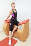 Girl in sportwear using relax massage equipment healthy spa salon Stock Image