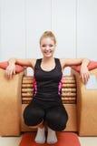 Girl in sportwear using relax massage equipment healthy spa salon Stock Photo