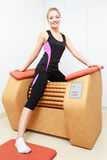 Girl in sportwear using relax massage equipment healthy spa salon Stock Image
