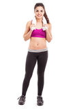 Girl in sporty outfit taking break Royalty Free Stock Photography
