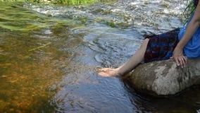 Girl spray legs water stock video
