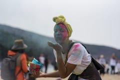 Geoje, SOUTH KOREA - MARCH 2018: Holi festival. The girl spray powder paints at Holi Royalty Free Stock Photo