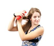 Girl spraying hair over white Stock Photos