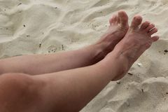The girl spread her toes. In the frame two legs royalty free stock photography