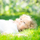 Girl in spring. Happy girl lying outdoors in spring park Stock Photos