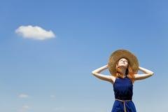 Girl at spring blue sky background. Stock Image