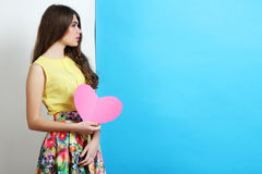 Girl in spring clothes with pink heart Stock Photos