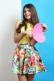 Girl in spring clothes with pink heart Stock Images