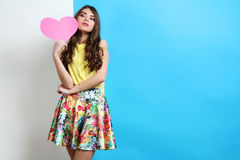 Girl in spring clothes with pink heart Royalty Free Stock Image