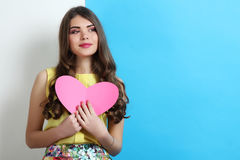 Girl in spring clothes with pink heart Royalty Free Stock Images