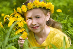 Girl in spring dandelion wreath Royalty Free Stock Image