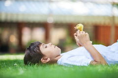Girl with a spring duckling Stock Photo