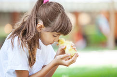 Girl with a spring duckling Royalty Free Stock Photo