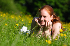 Girl on a Spring Field Stock Photography