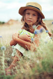 Girl in spring field Royalty Free Stock Photo