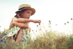 Girl in spring field Stock Images